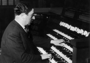 FRANCE - NOVEMBER 21: Maurice DURUFLE at the great organ of Saint Etienne du Mont's Church on November 21, 1956. (Photo by Keystone-France/Gamma-Keystone via Getty Images)